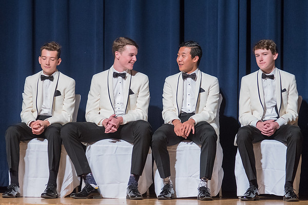 From left, homecoming king candidates Nick Goebel, Brendan Kane, Micah Rentschler and Luke Vetter await for the crowning moment during Mankato Loyola's homecoming coronation on Wednesday evening. Photo by Jackson Forderer
