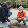Brennan Gerstbauer (right), 6, from St. Peter, is shown different types of soil by Kristin Brennan, a soil scientist with National Resources Conservation Service on the Gustavus campus on Tuesday as part of the Nobel Conference. This year's theme focuses on dirt and soil. Photo by Jackson Forderer