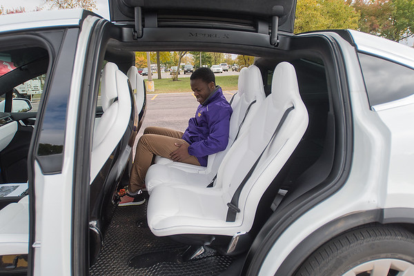 David Bassey, a graduate student at Minnesota State University, checks out the interior or a Tesla Model X during the Recharge Mankato event held on Saturday. Photo by Jackson Forderer