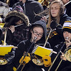 Mankato East pep band members brace themselves against the wind while playing during the Mankato West versus Mankato East football game Wednesday at Blakeslee Stadium.