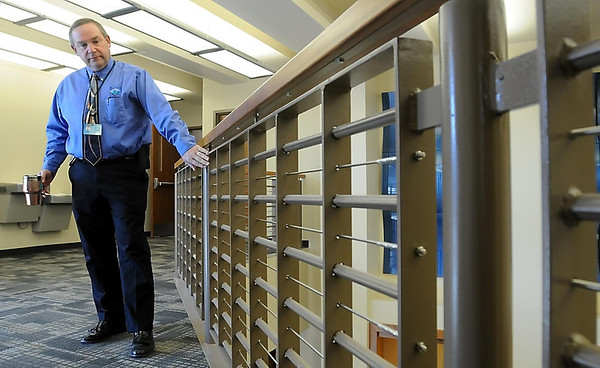 Mankato Public Safety Director Todd Miller points out railings in the entry way of the remodeled Mankato Public Safety Center that were fashioned from old doors salvaged from the jail in the old Law Enforcement Center.