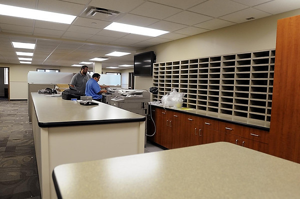 The patrol officers work area features mail slots and a large work counter.