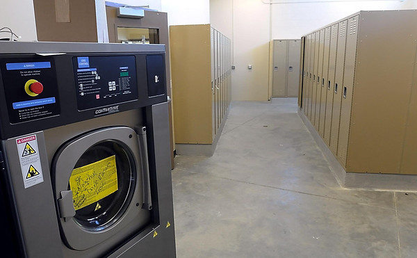 Special machines for washing and drying fire fighter's turn-out gear are located in a locker room that can easily be hosed down when they return from a call.