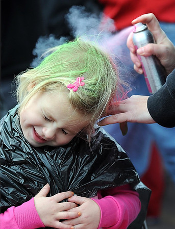 Bella Cornish, 3, has her hair colored before the start of Saturday's Kids K.