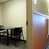 There are several  small interview rooms near the investigator's work area.