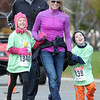 Pat Christman<br /> Diana Bjorneberg and her husband Brent run with their two children Abby, 8, and Tommy, 7, during the Kids K Saturday at MSU.