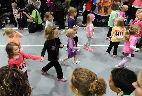 Pat Christman<br /> A group of girls head for the finish line of the girls division of the Toddler Trot Saturday.