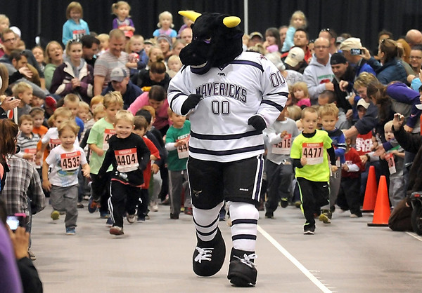 Pat Christman<br /> Children chase Minnesota State University mascot Stomper during the boys race of the Toddler Trot at the Scheels Sport and Health Expo Saturday at Myers Field House.