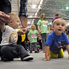 Pat Christman<br /> It's a race of inches during the Diaper Dash as one baby crawls past another during the Schells Sport and Health Expo Saturday at MSU.