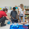Media specialist Mandy Stenzel (left) helps TraQuon Davis, 10, and Clara Hanke, 9, get their iPads set up with a Dash robot while Edyn Alexander (far right), 9, reaches for her Dash during a Makerspace class at Jefferson Elementary. Fourth-graders at the school in the Makerspace class also create their own video game and computer animations. Photo by Jackson Forderer