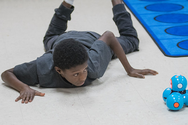 TraQuan Davis, 10, watches his Dash robot glide across the floor after giving it instructions on an iPad during a Makerspace time at Jefferson Elementary school. Photo by Jackson Forderer
