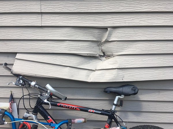 Airborn rocks from a quarry blast Tuesday morning damaged an apartment building at 601 Harper St. in Mankato. The city of Mankato suspended all blasting after public safety officials witnessed the flying debris from the Jefferson Quarry operated by Jordan Sands. File photo