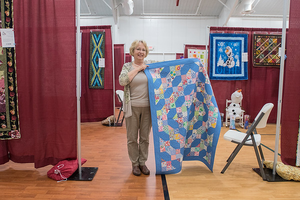 Darlene Zimmerman holds one of her favorite quilts at the Ewenique Quilt Show at the Sunrise Assemblies of God Church in St. Peter on Saturday. Photo by Jackson Forderer