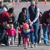 Payton Brinkman (center), 1, jumps out to an early lead in the Toddler Trot on Saturday, as events for this year's Mankato Marathon got underway on the Minnesota State University campus. Photo by Jackson Forderer