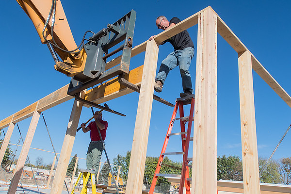 Steve Krone (left) and Jeff Schauer put up headers on top of the walls being put up at the new warming house being built adjacent to the swimming facility at Spring Lake Park in North Mankato. Photo by Jackson Forderer