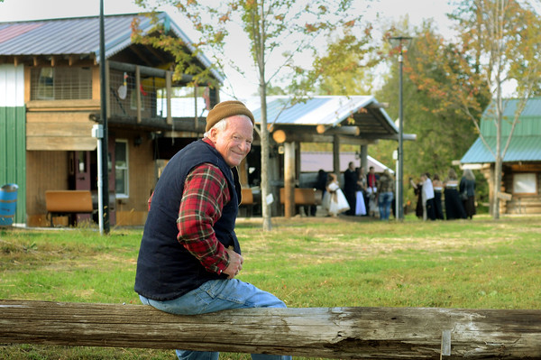 Remodeled and relocated buildings, now far removed from the flood plain of the nearby Le Sueur River, spread out behind Jack McGowan on his farm south of Mankato. The site will host the annual History Fest next Saturday. Photo by John Cross