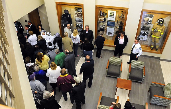Mankato Public Safety director Todd Miller (at right, in white) watches as visitors file in for a tour of the newly renovated Mankato Public Safety Center Tuesday. The $11.85 million renovation will bring the police and fire departments under one roof for the first time ever.