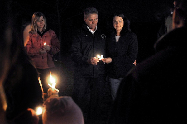 "Minnesota State University head football coach Todd Hoffner and his wife Melodee light candles with supporters during a vigil outside the Hoffners' Eagle Lake home Tuesday night. He is scheduled to be in court today for charges of creating and possessing child pornography for recordings he made of his own children. His attorney has asked a judge to dismiss the charges. In a statement released Tuesday, the Hoffners thanked friends, family and others for their support. ""The family is overwhelmed by these compassionate and thoughtful expressions,"" the statement said. ""This outreach by the greater Mankato and Eagle Lake communities has been a source of strength and encouragement in these trying times both personally and professionally."
