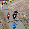 Mankato Half Marathon participants string out along the trail running along the Minnesota River.