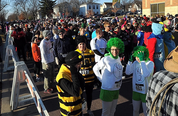 Some of the approximately 1,400 runners get ready for the start of the St. Peter Halloween Fun Run Saturday.