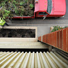 John Cross<br /> A city worker cleans out flower boxes along Riverfront Drive on Wednesday following a couple of mornings of sub-freezing temperatures that brought the growing season to an end.
