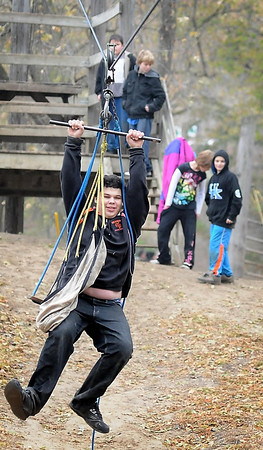 John Cross<br /> Youngsters visting the McGowan Farm ride a zipline, just one of several attractions at the farm located south of Mankato that will have to be dismantled because of a recent FEMA ruling.