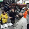 Pat Christman<br /> MTU Onsite Energy's Matthew Bentley explains the manufacturing process behind the company's generators (background) during Saturday's Tour of Manufacturing.