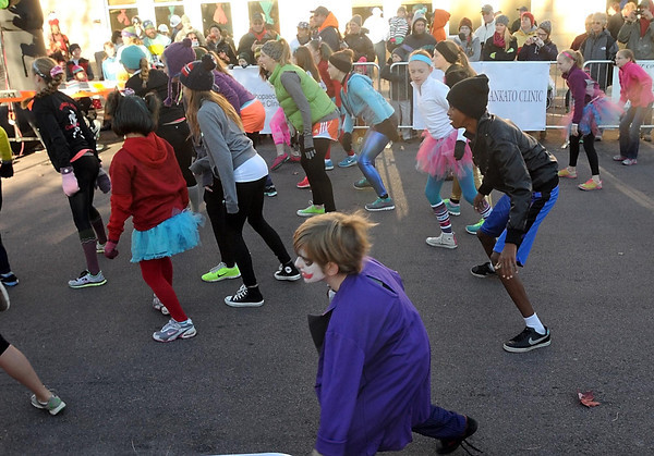 "Pat Christman<br /> A flash mob dances to Michael Jackson's ""Thriller"" before Saturday's run."