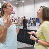 Heather Kampf (left) talks to an attendee at the Sport and Health Expo after Kampf gave a talk as the main presenter of the expo. Kampf is the four-time United States National States Champion in the one-mile road race. Photo by Jackson Forderer