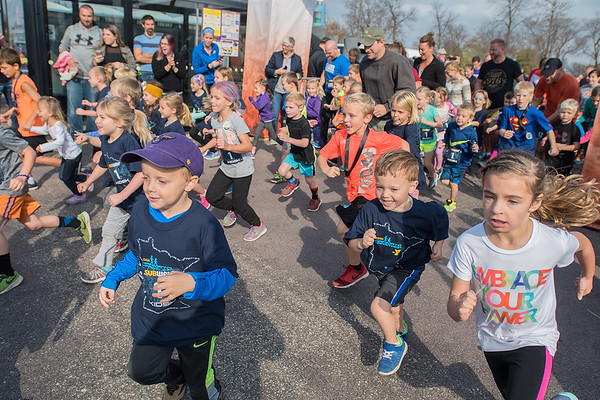 Children participants in the Kids K start their one kilometer run in Parking Lot 21 at Minnesota State University on Saturday. Saturday's races included a diaper dash and toddler trot as well as a 5K. Photo by Jackson Forderer