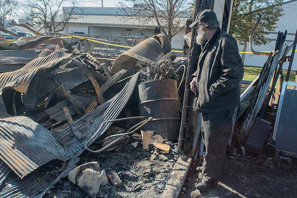 "Dennis Fenske looks over his building that was burned down on Friday night in the downtown area of Lafayette. ""It was built in 1917 and burned down in 2017,"" said Fenske of the building but added that he was thankful no one was hurt by the fire. Photo by Jackson Forderer"