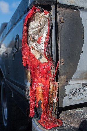 The heat from the intense blaze melted the brake lights on Dennis Fenske's truck that was parked behind one of the buildings that burned down in Lafayette. Sixteen area fire departments responded to the fire that started Friday night and destroyed two buildings. Photo by Jackson Forderer