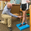Todd Kruse, owner of Wenger Physical Therapy, works with a patient who had a meniscus transplant in her knee after being on the Minnesota State dance team. Kruse recently became the owner of Wenger Physical Therapy, located at 1681 Commerce Drive in upper North Mankato. Photo by Jackson Forderer
