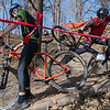 Ben Foley (right) of Highland Park High School crashes while making a turn and trying to avoid Alec Gooder of Hudson High School (left) who was getting back on his bike after he also crashed on the same descending turn. The two raced in the Minnesota State High School Mountain Bike Championship Race held at Mount Kato on Saturday. Photo by Jackson Forderer
