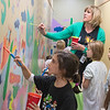 Amy Muehlenhardt (upper right) gives instructions to students on how to paint a mural as the after school group Art Club met at Bridges Elementary School on Thursday. Muehlenhardt has been teaching art for 12 years and was awarded Elementary Art Educator of the Year from Art Educators of Minnesota. Photo by Jackson Forderer