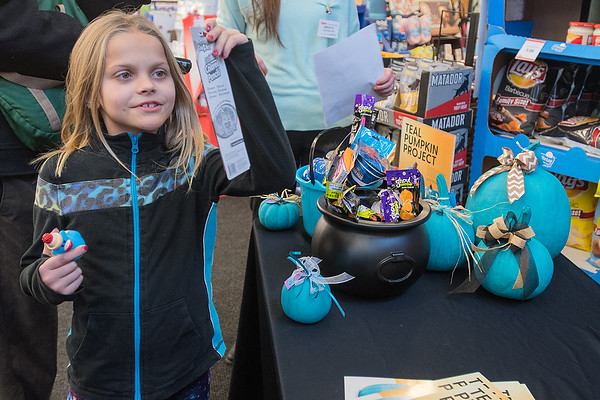 Justise Thul, 7, looks at an item that was at the Teal Pumpkin Project display at Hy Vee. The project promotes awareness of food allergies in children and suggests people have non-food item options for trick-or-treaters on Halloween for those children. Photo by Jackson Forderer