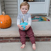 Hudson Benson, 2, on his front step with a teal pumpkin. Hudson has celiac disease and is also lactose intolerant. Photo by Jackson Forderer