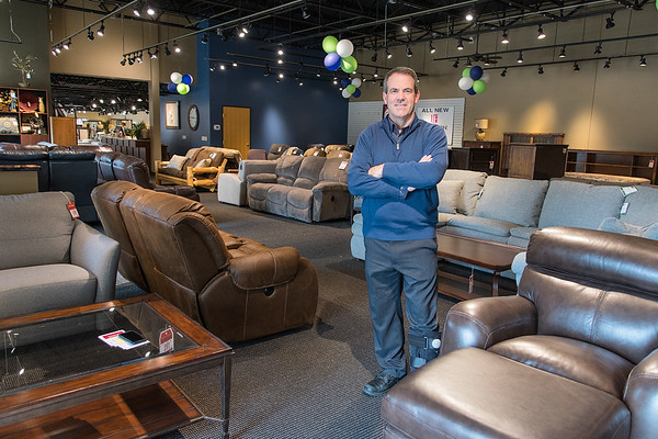 Todd Johnson of Johnson Furniture in the new clearance area of the store.
