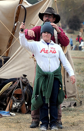 Gibbon-Fairfax-Winthrop sixth grader Amelia Schuenemeyer learns how to crack a whip from Steve Swanson during History Fest Thursday at the McGowan farm south of Mankato.