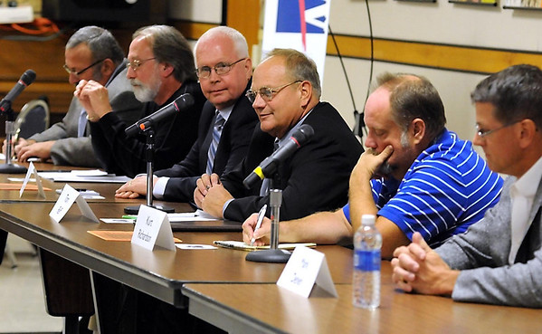 North Mankato City Council candidate Tom Rieff, center, speaks during a candidate forum Wednesday at South Central College.