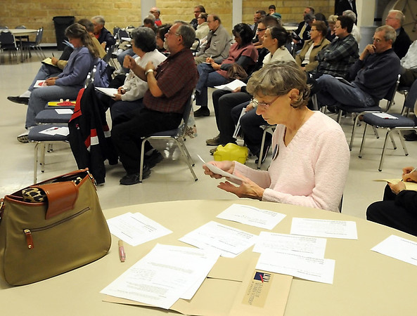 Lynn Solo, of the St. Peter Area League of Women Voters, sorts through questions from the audience during a North Mankato City Council candidate forum Wednesday at South Central College.