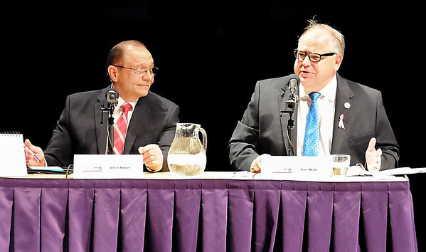 1st Congressional District candidate Allen Quist (left) listens to Tim Walz during a debate between the two candidates Tuesday at Minnesota State University's Ostrander Auditorium.
