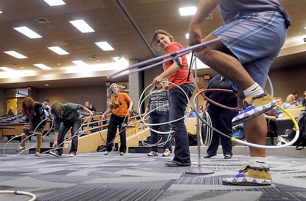 People watch as Kevin Locke teaches some of the moves used in Native American hoop dancing during a seminar Thursday at the Global Connections Conference at South Central College.