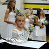 Pat Christman <br /> Aaron Baxa holds the homecoming queen's crown as Nora Kath and the homecoming queen candidates wait for coronation Friday.