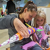 Abbi Simonson (left) helps her daughter Adalynn, 6, design and decorate a rocket at the Children's Museum of Southern Minnesota on Wednesday. Rocket building was one of eight activities in which girls could learn about STEM subjects. The rockets were then blasted off by releasing pressurized air into the bottom of the rockets. Photo by Jackson Forderer