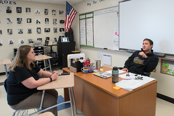 LaRae Ludwig (left) meets with Tony Brunelle in his classroom at Le Sueur-Henderson High School. Ludwig, who is a mentor for new teachers, said they meet about once a month. Ludwig said she has seen a decline in teaching in her 22 years as a teacher. Photo by Jackson Forderer