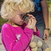 Elyse Lentz, 7, uses a magnifying glass to get a closer look at a rock at the Children's Museum of Southern Minnesota during the International Day of the Girl on Wednesday. The science activity was one of eight STEM activities that was put on by the museum. Photo by Jackson Forderer