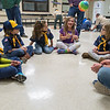 Dani Chatleain (third from right) throws a ball back to pack leader Tyler Doering as the new girl Boy Scouts of Pack 91 introduced themselves at their first meeting at Washington Elementary on Thursday. Photo by Jackson Forderer