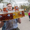 Kyle Marti carries 14 steins of beer to the main tent at Octoberfest, held at Schell's Brewery in New Ulm on Saturday. With each stein roughly weighing five pounds, Marti was carrying 70 pounds of glass and beer, which was not however, his personal best of 17 steins. Photo by Jackson Forderer