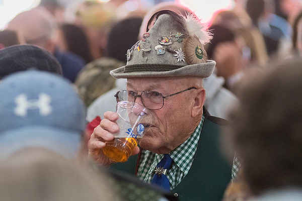 Leo Block from Rapid City, South Dakota drinks a Fest beer as the main tent filled up at Octoberfest held at Schell's Brewery in New Ulm on Saturday. Block also danced to polka songs played by the Schell's Hobo Band. Photo by Jackson Forderer